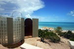 A spectacular glass block shower, with expansive views to the sea, graces the dune on the ocean side of Casa V.